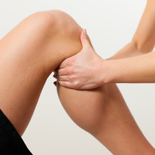 massaging a knee Sports Massage Therapy